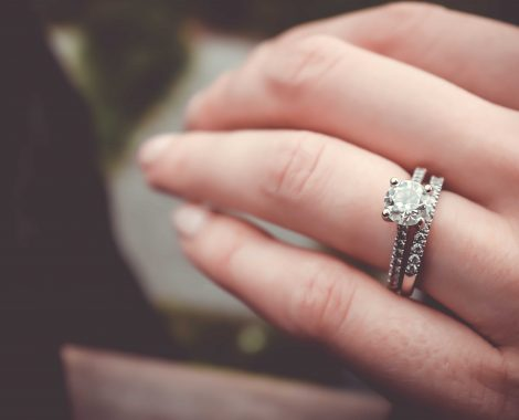 Diamond engagement ring with wedding band on ring finger